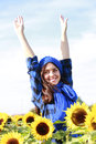 Happy woman in sunflower field Royalty Free Stock Photography