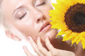 Happy woman with sunflower young attractive Royalty Free Stock Photography