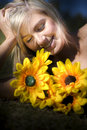 Happy woman with sunflowers Stock Photography