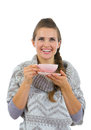 Happy woman in sweater having hot beverage Royalty Free Stock Image