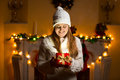 Happy woman in sweater holding glowing gift box at christmas eve portrait of Royalty Free Stock Photos