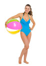 Happy woman in swimsuit with beach ball Royalty Free Stock Photo