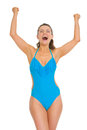 Happy woman in swimsuit and hat rejoicing success young Royalty Free Stock Photo