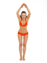Happy woman in swimsuit ready to jump in water Royalty Free Stock Photo
