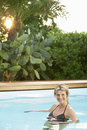 Happy woman in swimwear swimming in pool portrait of beautiful middle aged Royalty Free Stock Photos