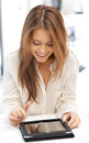 Happy woman with tablet pc computer picture of Royalty Free Stock Image