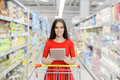 Happy woman with tablet shopping at the supermarket young girl in a market store a pc in a department store Royalty Free Stock Image