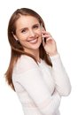 Happy woman talking on cell phone over white background Stock Image