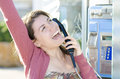 A happy woman talking at phone Stock Photography