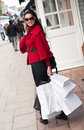 Happy  woman talking on the phone during shopping Royalty Free Stock Photo