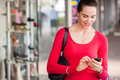 Happy woman texting on mobile phone beautiful a or smart whilst out shopping Royalty Free Stock Images