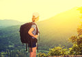 Happy woman tourist with a backpack on nature sunset Royalty Free Stock Photos