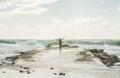 Happy woman tourist enjoying waves of stormy Mediterranean sea Royalty Free Stock Photo