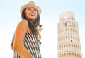 Happy woman tourist at Leaning Tower of Pisa Royalty Free Stock Photo