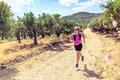 Happy woman trail running in beautiful mountains Royalty Free Stock Photo