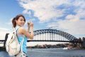 Happy woman traveler in australia photo by camera Stock Photos