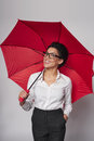 Happy woman with umbrella african american business standing red over gray background Stock Image