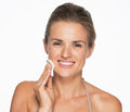 Happy woman using cotton pad to remove makeup isolated on white Stock Photography