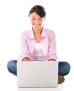 Happy woman using laptop a computer isolated over white Stock Image