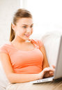 Happy woman using laptop at home picture of Royalty Free Stock Photo