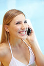 Happy woman using phone at pool Royalty Free Stock Photo