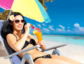 Happy woman on vacation enjoying at beach Stock Image