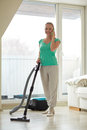 Happy woman with vacuum cleaner at home Royalty Free Stock Photo