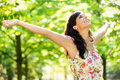 Happy woman vitality on spring park carefree in or summer forest raising arms with happiness hope and caucasian girl relaxing and Stock Photography