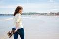 Happy woman walking along the seashore
