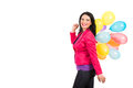 Happy woman walking and holding balloons to copy space with colorful on her shoulder isolated on white background Royalty Free Stock Photography