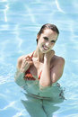 Happy woman in water beautiful swimmingpool enjoying summer Stock Photo