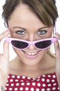 Happy woman wearing pink framed sunglasses young Stock Photography