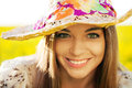 Happy woman in a wicker hat Royalty Free Stock Image