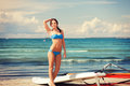 Happy woman with wind surf on the beach picture of Stock Image