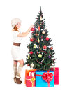 A happy woman in winter clothes decorating the christmas tree young and image is isolated on white background Royalty Free Stock Images