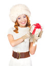 A happy woman in winter clothes holding a present young and christmas the image is isolated on white background Stock Photos