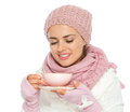 Happy woman in winter clothing enjoying cup of tea Royalty Free Stock Image