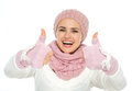 Happy woman in winter clothing showing thumbs up Royalty Free Stock Image
