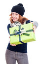Happy woman in winter hat with present giving isolated on white background Stock Images