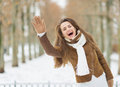 Happy woman in winter jacket saluting outdoors Royalty Free Stock Photography