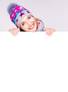 Happy woman in winter outerwear over white banner hands at studio Stock Photo