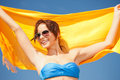 Happy woman with yellow sarong on the beach picture of Stock Photography