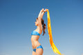 Happy woman with yellow sarong on the beach picture of Royalty Free Stock Image