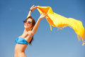 Happy woman with yellow sarong on the beach picture of Royalty Free Stock Photo