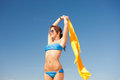 Happy woman with yellow sarong on the beach picture of Royalty Free Stock Images