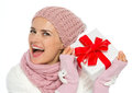 Happy womanshaking Christmas present box Royalty Free Stock Images