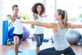 Happy women with arms outstretched in fitness club Stock Photography