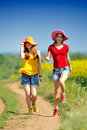 Happy women on blooming rape field in summer Royalty Free Stock Photography