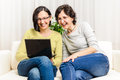 Happy women chat browsing home personal computer Royalty Free Stock Photo