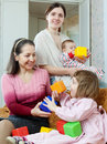 Happy women with children in home interior Stock Photo